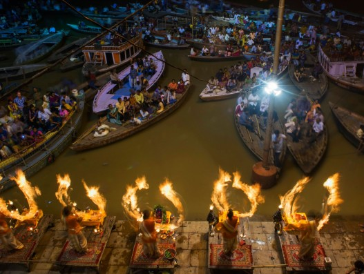 Aarti is a Hindu religious ritual of worship in which light from wicks soaked in ghee (purified butter) is offered to one or more deities India banita Tour
